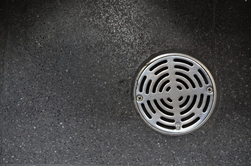 bathroom drain silver with grey background