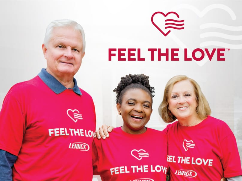 Three people next to each other wearing feel the love shirts